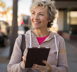 Woman walking with tablet