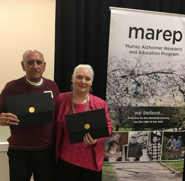 Monique and Gerard receiving an award from MAREP for their volunteer work